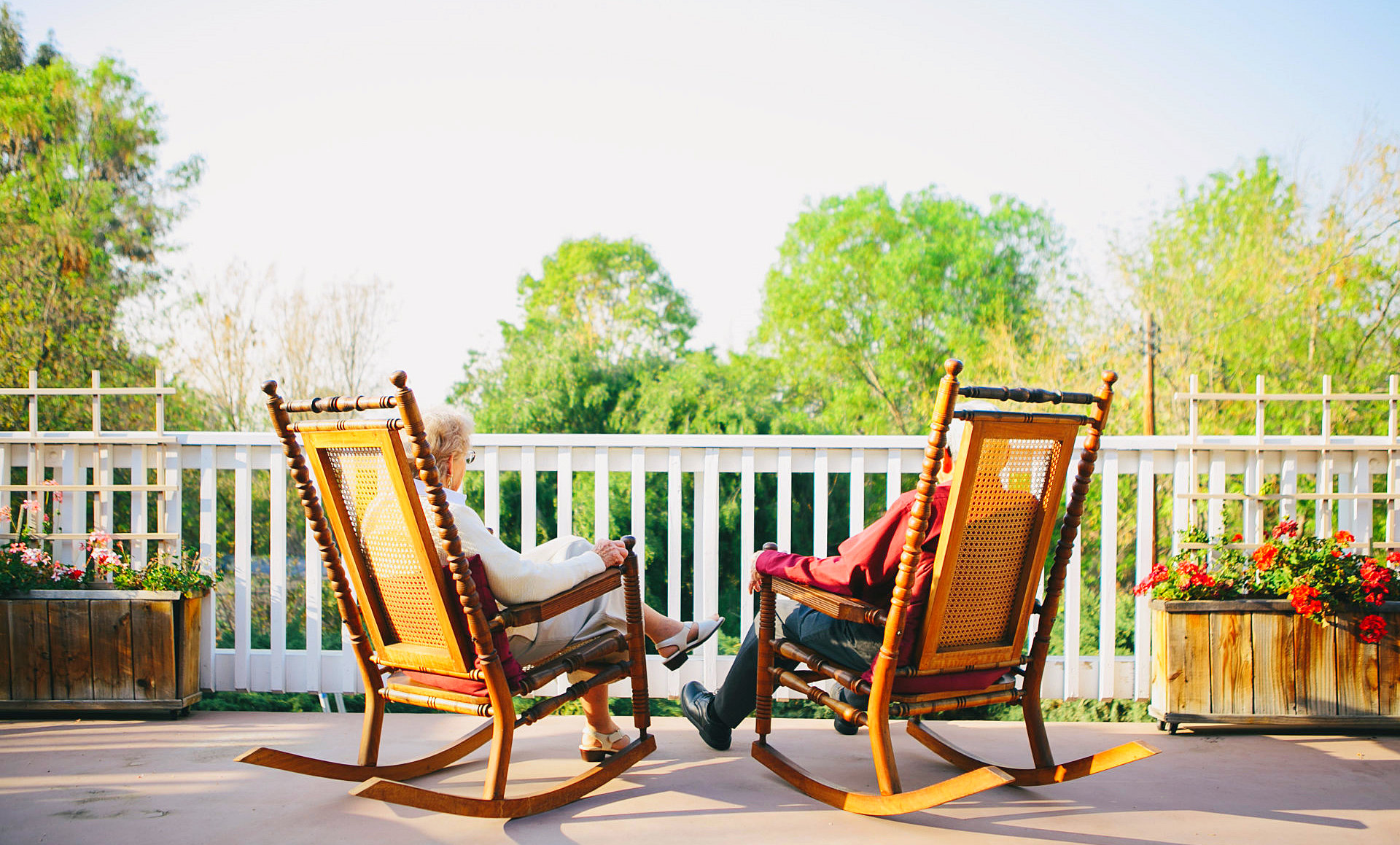 senior couple sitting on the rocking chair
