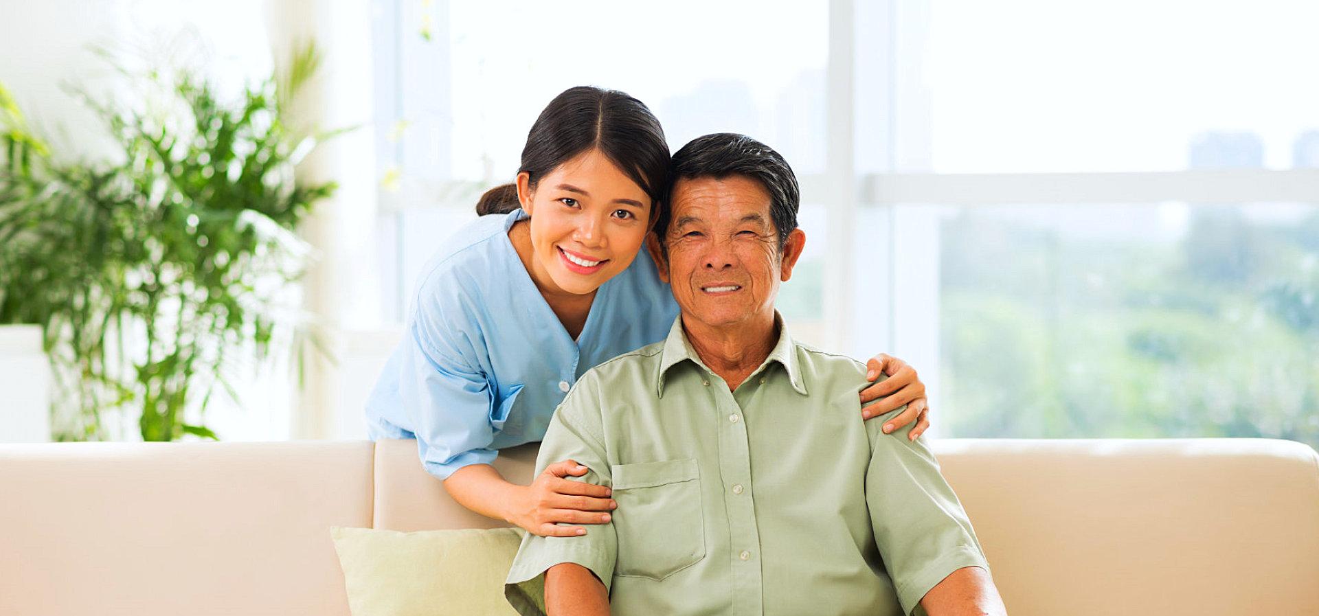 happy senior man and caregiver