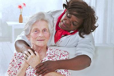 caregiver taking care of senior woman