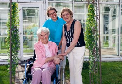 happy caregiver with senior women